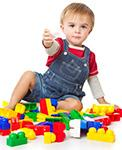 Little Boy Holding Lego Block