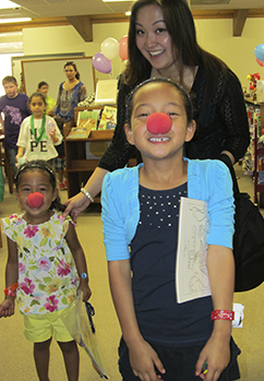 Two Children with Red Noses for 'Put Your Nose in a Book'