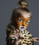 Little Girl with Tiger Face Paint