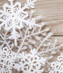Paper Snowflakes on Wooden Surface