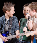 Three Boys with Guitars and Microphone