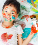 Girl with Paint on Her Face, Clothes and Hand