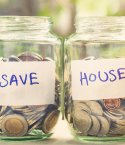 Two Jars with Coins in Them Labeled Save and House