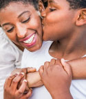 Young Teen Kissing Mother's Cheek