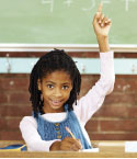 Girl Raising Hand in Front of Chalk Board