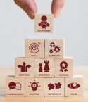 Hand Stacking Blocks with Leadership-Related Icons