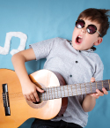 Boy with Sunglasses Playing Guitar