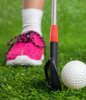 Pink Shoe, Golf Putter and Ball on Grass