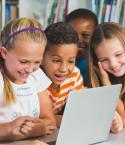 Children Gathered Around a Laptop
