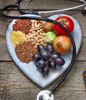 Fruits and Grains on Heart-Shaped Cutting Board with Stethoscope