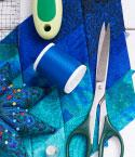 Quilted Fabric with Scissors, Rotary Cutter & Thread